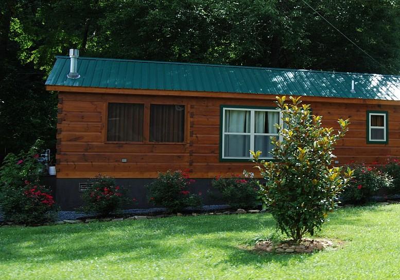 Log cabin with brick underpinning joy studio design for Brick cabin